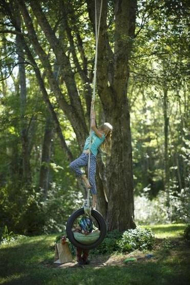 Ava Dennesen played on a tire swing with her brother, Eli.